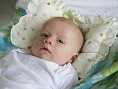 Men and Asian newborn babies